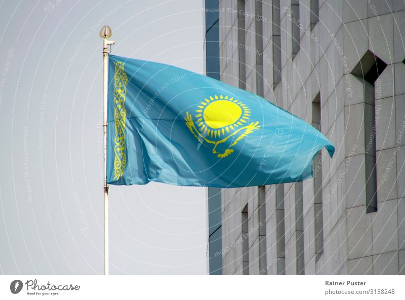 National flag of Kazakhstan in the wind almaty astana nur-sultan Town Downtown Flag Ensign Blue Yellow Gray Attachment Nationalities and ethnicity Colour photo