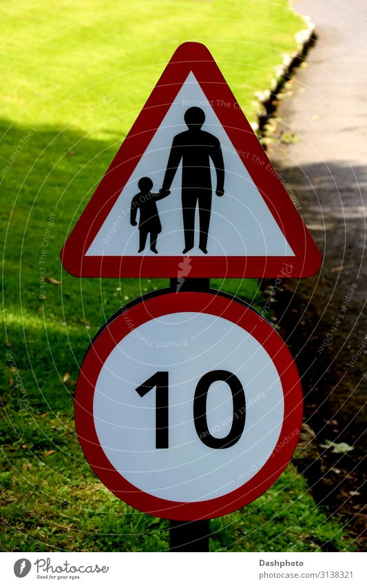 Speed and Children Crossing Road Sign on a Country Road Green White Red Leaf Black Street Adults Lanes & trails Grass Transport Walking Signage Safety