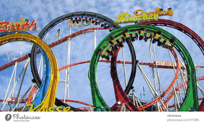 head over heels into pleasure... Roller coaster Carriage Railroad Fairs & Carnivals Multicoloured Scream Leisure and hobbies Olympics overhead Sky Tall Fear