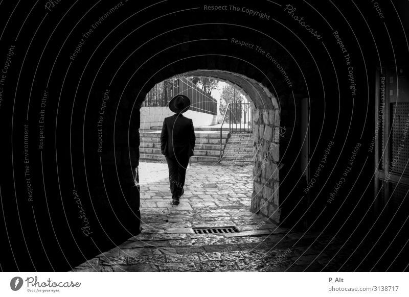 God's path Masculine Man Adults Back 1 Human being West Jerusalem Israel Town Old town Gate Wall (barrier) Wall (building) Door Tunnel Suit Hat Stone Joy Ease
