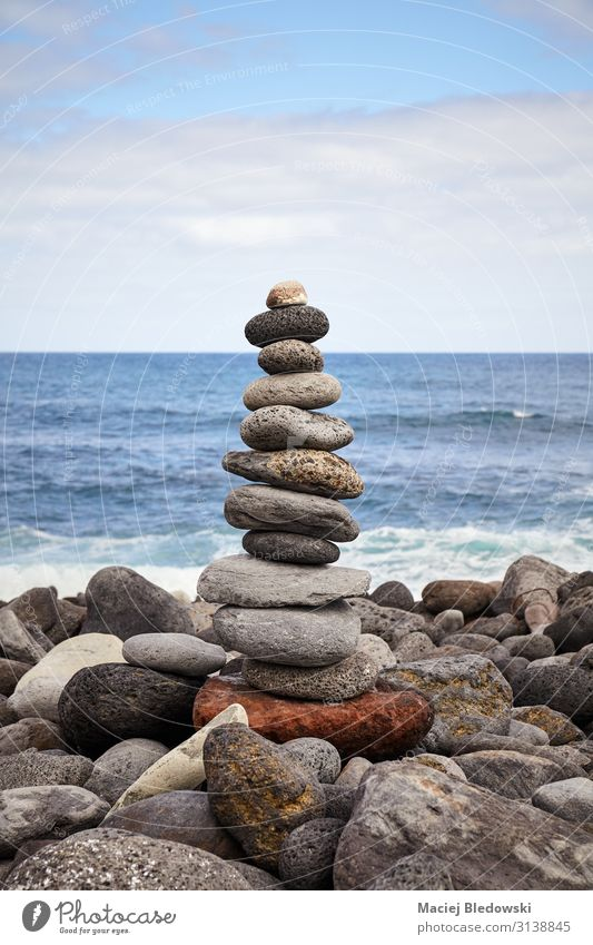 Stone stack on a beach, balance and harmony concept. Lifestyle Alternative medicine Wellness Harmonious Well-being Contentment Relaxation Meditation Beach Ocean