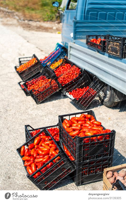 Small italian apo truck with tomatoes. Farmer sale tomatoes Food Vegetable Fruit Vegetarian diet Shopping Business Marketplace Street Stand Sell Fresh Natural