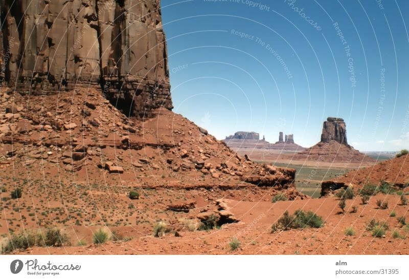 Nature Earth USA Desert Monument Blue sky Famousness Tourist Attraction Monumental Attraction Destination Monument Valley Monument Valley Rock formation Clear sky
