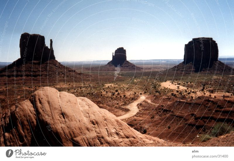 the rock Blue sky Desert Rock Rock formation Monument Valley Famousness Attraction Tourist Attraction Clear sky Cloudless sky Around-the-world trip Destination