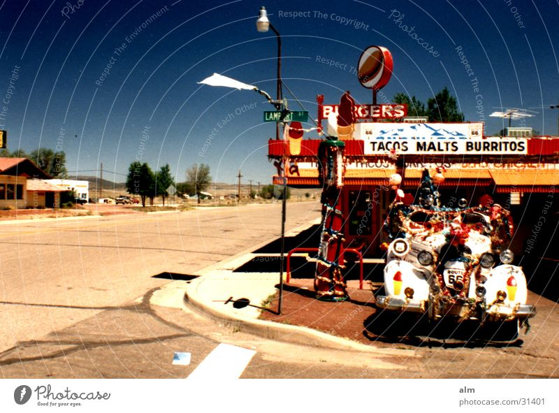Snow Cup Blue sky Kitsch Street Snack bar Street corner Outskirts Vintage car Eye-catcher Decoration Deserted Clear sky Cloudless sky Crazy Exceptional