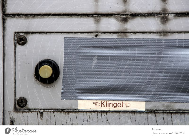 I'm ringing the bell... Mailbox Bell Adhesive tape Insulation Characters Signage Warning sign Old Dirty Sharp-edged Hideous Broken Gray Orderliness Mistrust