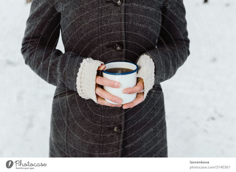 Woman's hands holding white enamel cup with hot drink Walking To go for a walk Hiking Young woman Hand Morning Caffeine Hold Cup Mug Beverage Breakfast Fingers