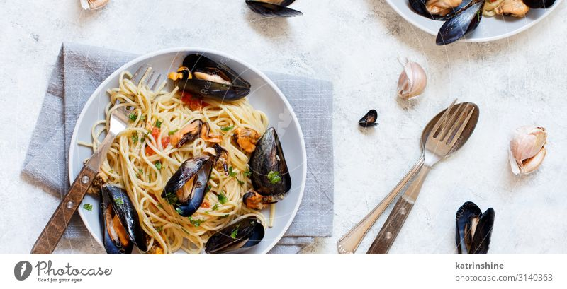 Spaghetti with mussels and tomatoes Seafood Lunch Plate Fork Spoon Restaurant Mussel Fresh Delicious pasta Italian Tomato negative space Copy Space Cooking