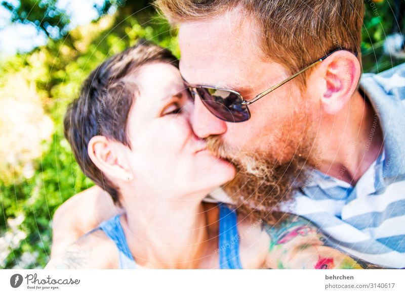 love| kissing couple Man Woman Affection Sunglasses Exterior shot Skin Adults Family & Relations Mouth Lips Nose Face Contentment Trust Safety (feeling of)