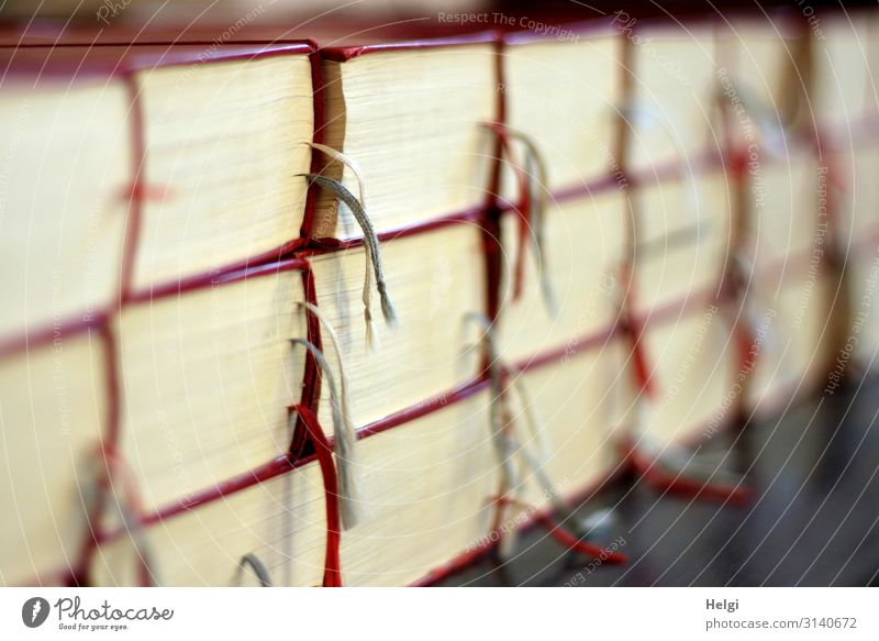 Close-up of many stacked songbooks with marking tapes in a church Church Dome Line String Lie Authentic Exceptional Uniqueness Gray Red White Moody Peace