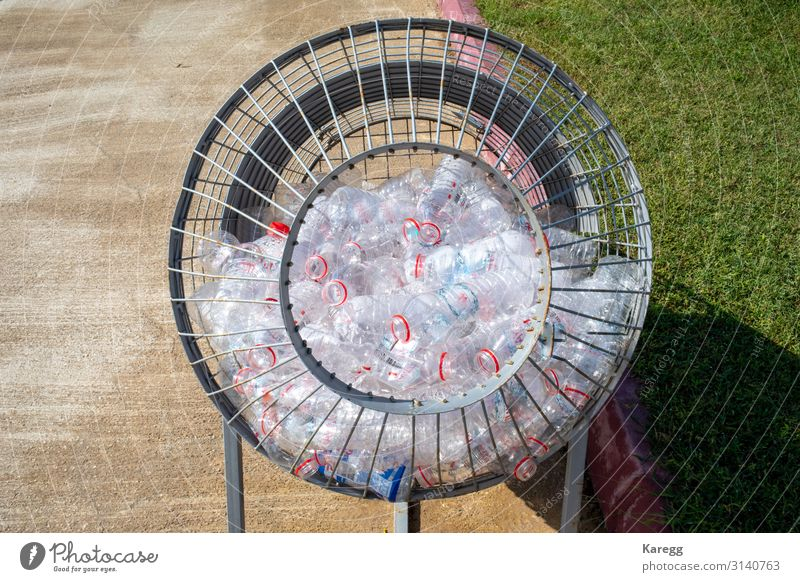 plastic bottles are collected in a metal basket Beautiful Child Human being Climate Packaging Plastic packaging Sack Container Glass Sign Trashy Recycling
