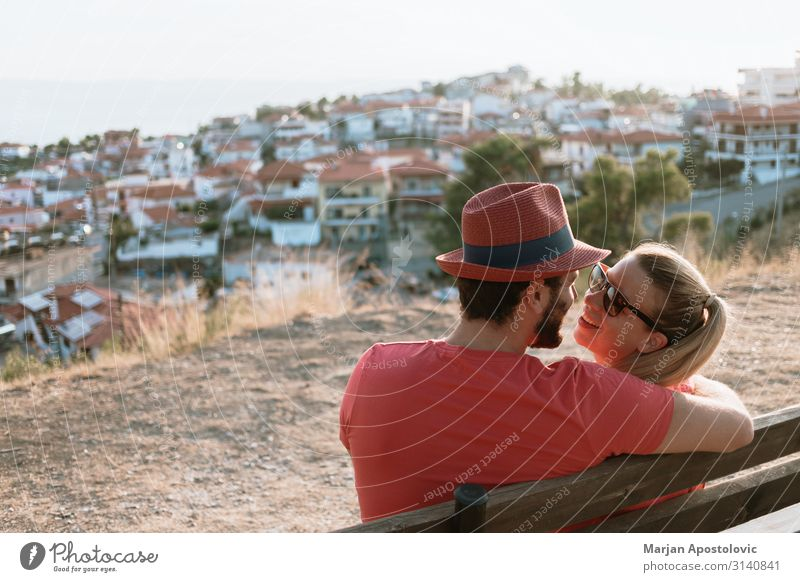 Young couple in love enjoying the view of the town and sunset Lifestyle Joy Leisure and hobbies Vacation & Travel Tourism Summer Summer vacation Valentine's Day