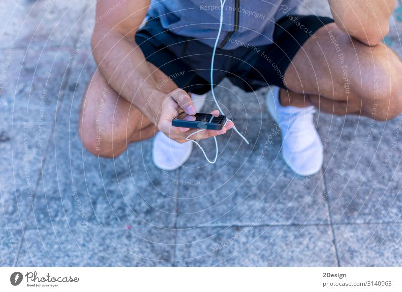 Close up of a Running man with a smart watch Lifestyle Body Relaxation Decoration Music Sports Jogging Telephone Cellphone Screen Technology Human being