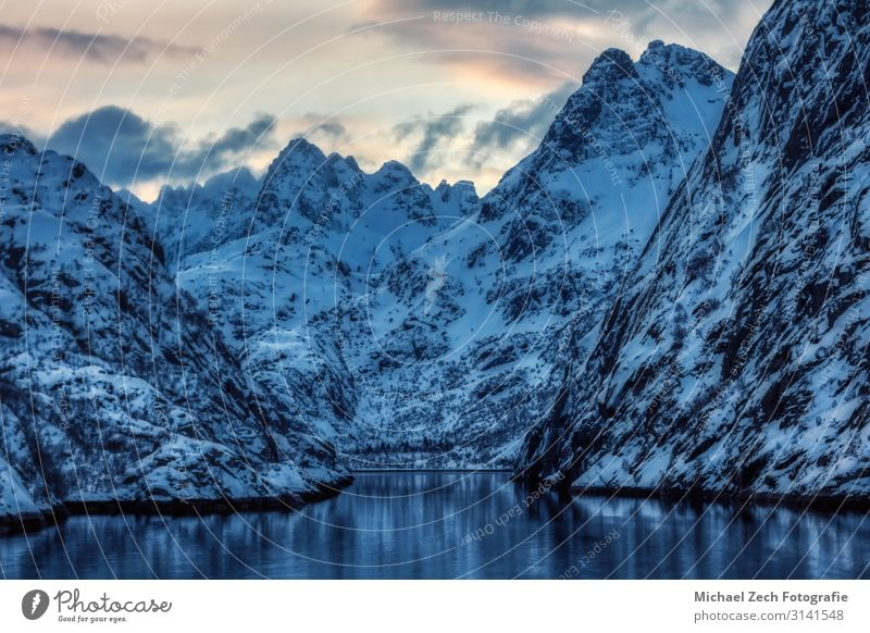 View to the entry of Trollfjord with snow-capped mountains Beautiful Adventure Island Winter Snow Mountain Hiking Climbing Mountaineering Nature Landscape Rock