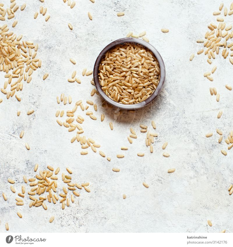 Brown rice in a wooden bowl with a spoon Nutrition Vegetarian diet Diet Bowl Spoon Table Wood Gray Rice integral whole grain Rustic health healthy Ingredients