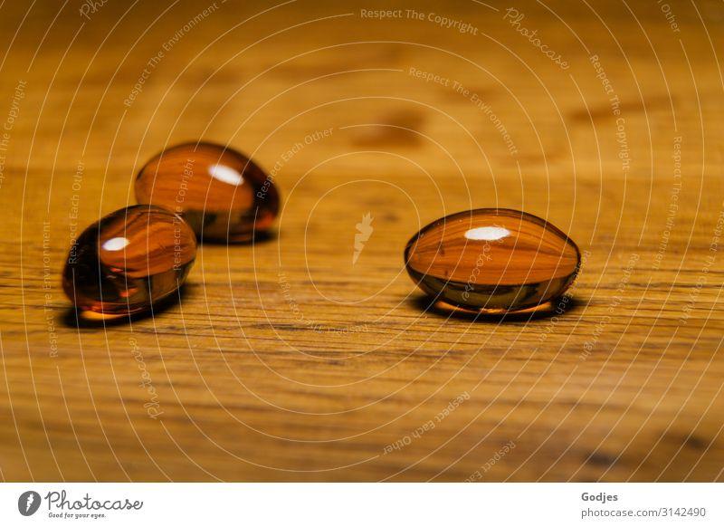 Capsules with black cumin oil on a wooden plate| Weltschmerz Wood Pill Black cumin Healthy Contentment weltschmerz Allergy Illness Nutrional supplement