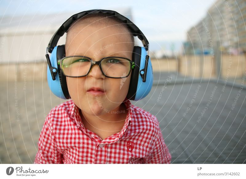 cute kid wearing headphones and glasses and making faces Lifestyle Human being Masculine Child Family & Relations Infancy Art Culture Youth culture Subculture