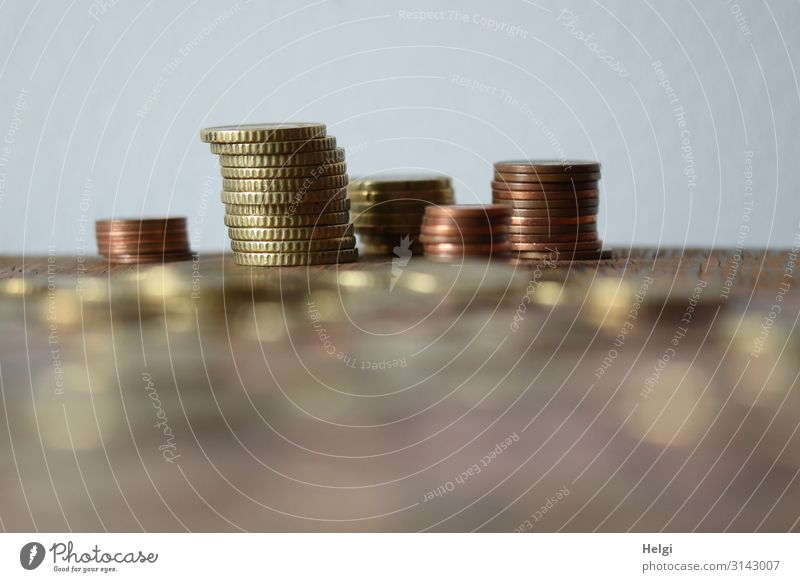 Small change is stacked on a table Coin Metal Money Lie Exceptional Brown Gold Gray Uniqueness Arrangement Thrifty Stack Save Collection Colour photo