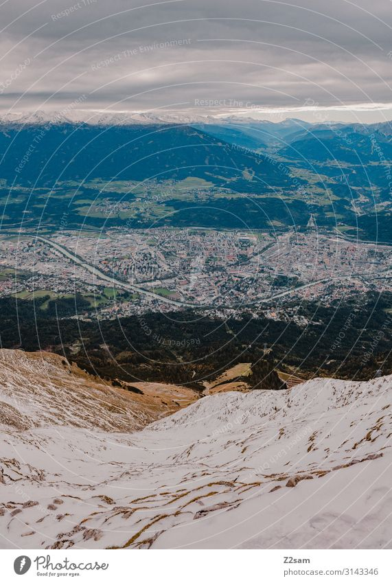 Nordkette / Innsbruck Sightseeing Nature Landscape Storm clouds Autumn Snow Alps Mountain Peak Town Gigantic Infinity Natural Colour Sustainability Perspective
