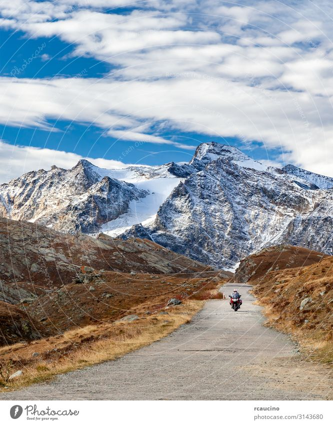 Motorcycle bike on mountain road in the Alps Human being Vacation & Travel Nature Man Landscape Winter Mountain Street Lifestyle Adults Autumn Snow Sports