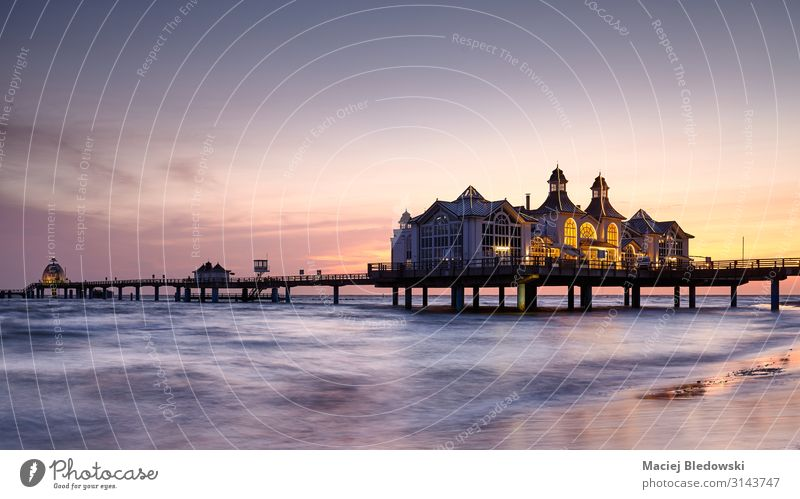 Pier in Sellin at purple sunrise, Germany. Vacation & Travel Tourism Sightseeing Summer Summer vacation Beach Ocean Island Waves Landscape Sky Coast Baltic Sea