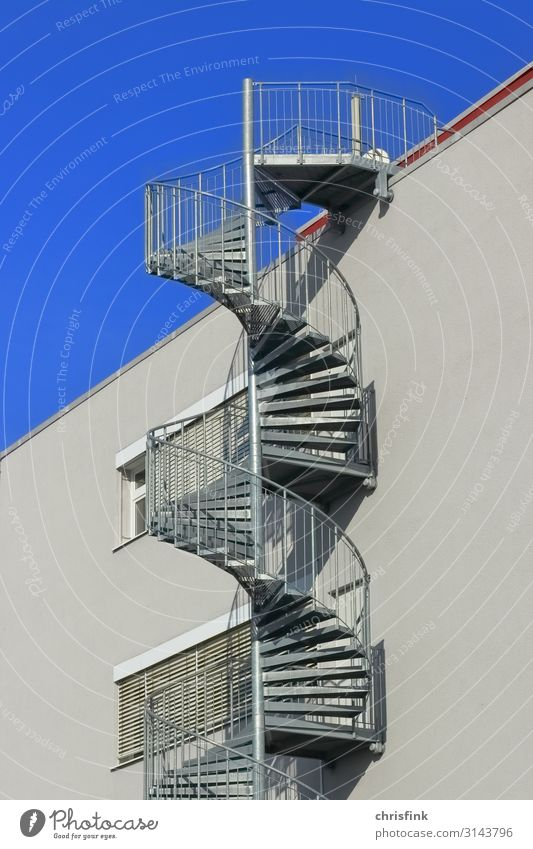 spiral staircase on house wall House (Residential Structure) Industrial plant Manmade structures Building Architecture Wall (barrier) Wall (building) Stairs