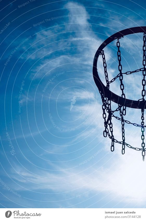 basketball hoop and blue sky Basketball Sky Blue Circle Iron chain Net Sports Sports equipment Playing Old Street Park Playground Exterior shot Minimal