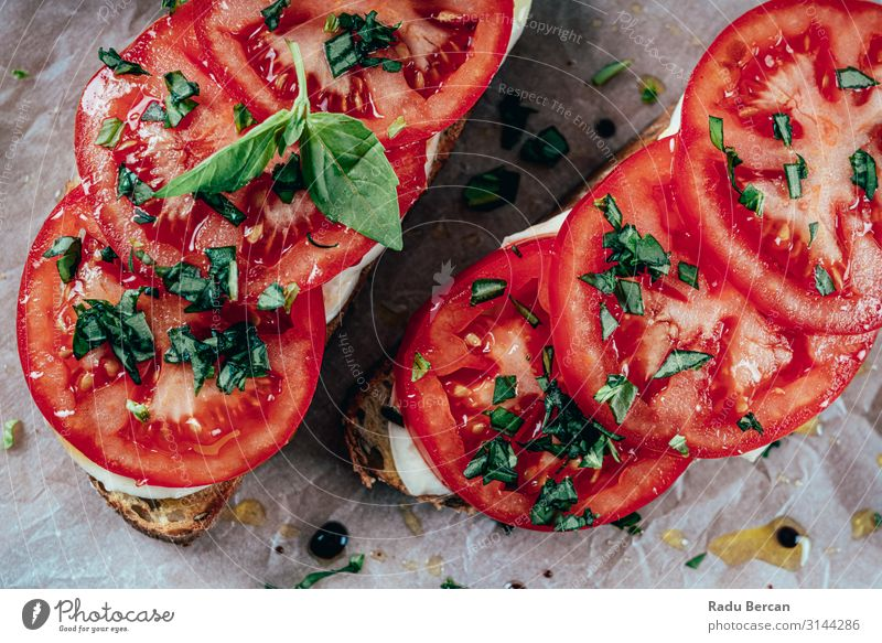 Caprese Toast With Mozzarella, Tomatoes And Basil Healthy Sandwich Bread Snack Appetizer bruschetta Meal Food Vegetarian diet Dinner Italian Cooking Diet