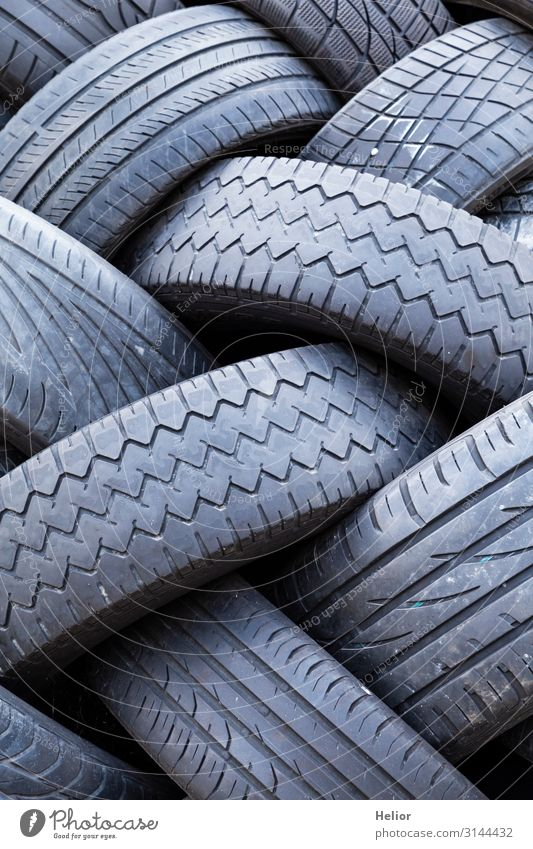Stacks of old worn car tires Environment Transport Road traffic Motoring Car Lie Old Environmental pollution Environmental protection Archaic Tire tread