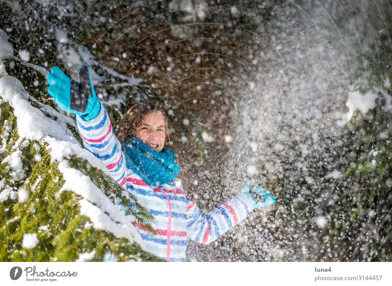 happy girl playing in the snow Joy luck Contentment Leisure and hobbies Playing Vacation & Travel Sun Winter Snow Child Landscape Weather Snowfall tree Forest