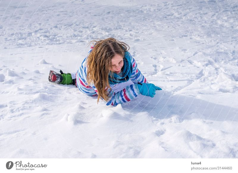 Girl falls in the snow Joy luck Contentment Leisure and hobbies Vacation & Travel Winter Snow Child girl Landscape Weather peel Laughter Happiness chill