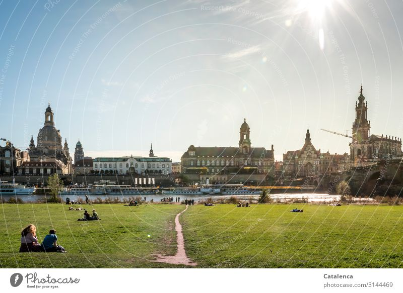 Sunny in the afternoon Human being Crowd of people Water Cloudless sky Autumn Beautiful weather Grass Meadow River bank Elbe Dresden Capital city Church Dome