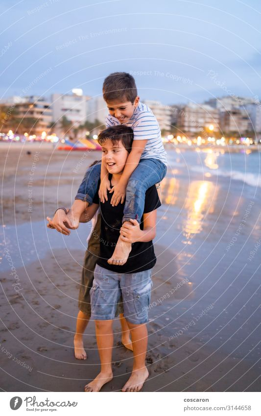 Children havig fun on the beach at sunset Lifestyle Joy Happy Beautiful Leisure and hobbies Playing Ride Children's game Vacation & Travel Summer Beach Ocean