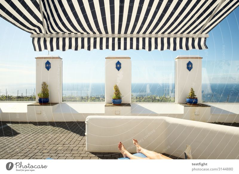 Human being Vacation & Travel Ocean Relaxation Legs Wall (building) Environment Feminine Wall (barrier) Vantage point Lie Island To enjoy Warm-heartedness