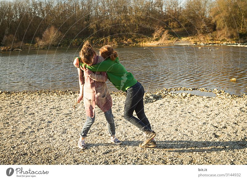 Two teenagers fighting at the waterfront Playing Martial arts Parenting Human being Feminine Young woman Youth (Young adults) Brothers and sisters Sister