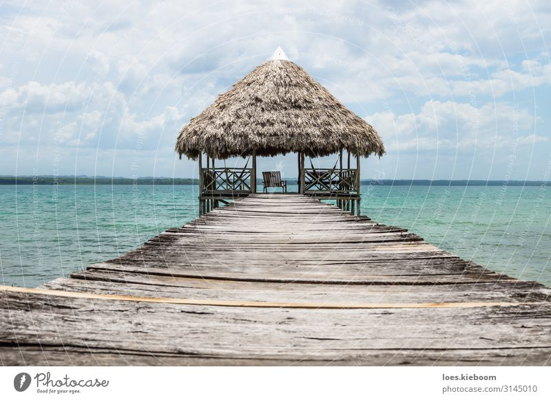 Wooden dock with palm roof, El Remate, Guatemala Relaxation Vacation & Travel Tourism Adventure Far-off places Freedom Summer Sun Beach Aquatics