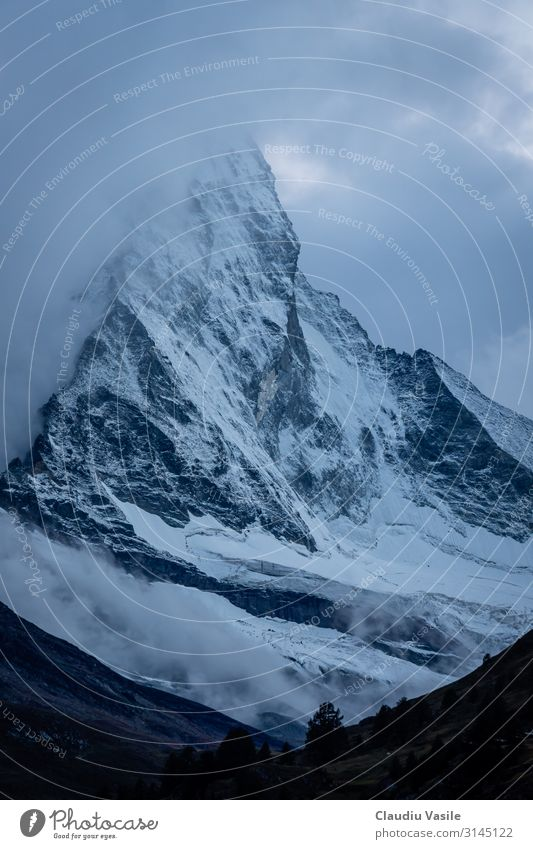 Matterhorn Covered In Clouds At Dusk Nature Landscape Earth Summer Winter Climate change Fog Ice Frost Snow Snowfall Mountain Glacier Freeze Vacation & Travel