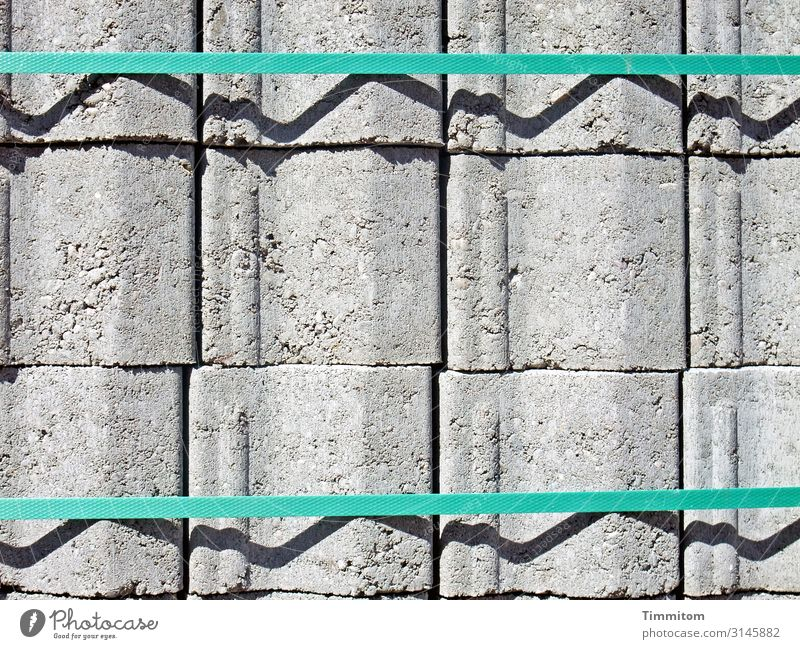 Calm before the storm Construction site Stone Plastic Wait Esthetic Gray Green Black Emotions Material Stack Colour photo Exterior shot Deserted Light Shadow