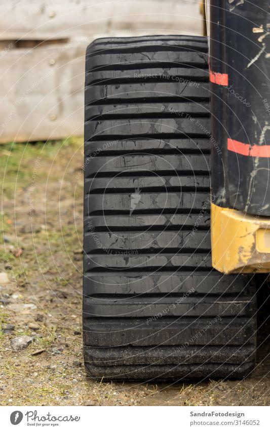 A big caterpillar wheel on a construction vehicle Design Engines Gear unit Wall (barrier) Wall (building) Transport Street Movement Power Help aged ancient