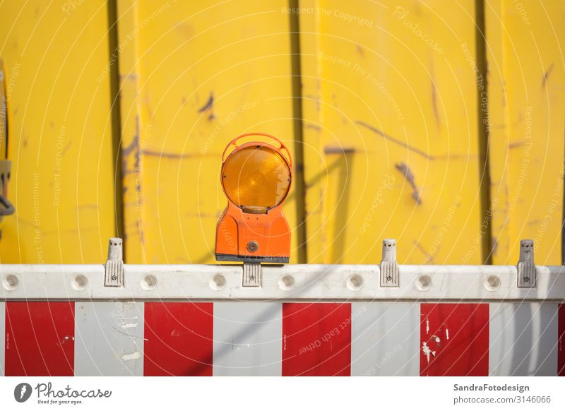 A barrier with reflector at a construction site Work and employment Workplace Construction site Environment Manmade structures Transport Road traffic Road sign