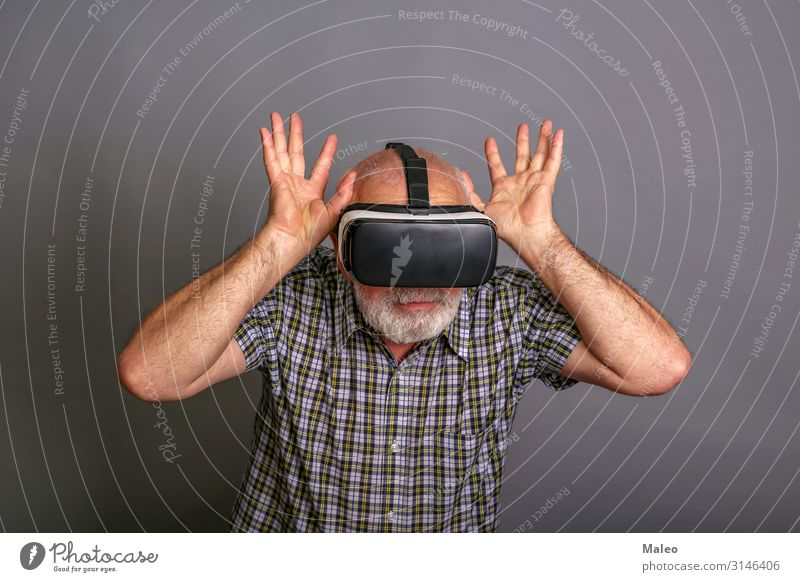 Man wearing virtual reality glasses. Studio recording, grey background Really Virtual VR Eyeglasses Panorama (Format) Playing Technology gadget Digital