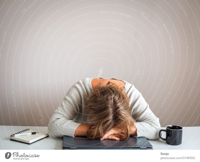 Depressed woman with her head on a laptop Feminine Woman Adults Life 1 Human being 45 - 60 years Frustration Stress Distress Exhaustion Office