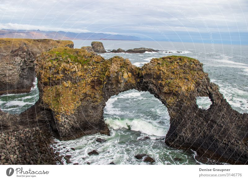 Rock bridge in the sea in Iceland Vacation & Travel Summer Winter Nature Water Waves Coast Ocean Looking Jump Hiking beautiful blue Europe landscape mountain
