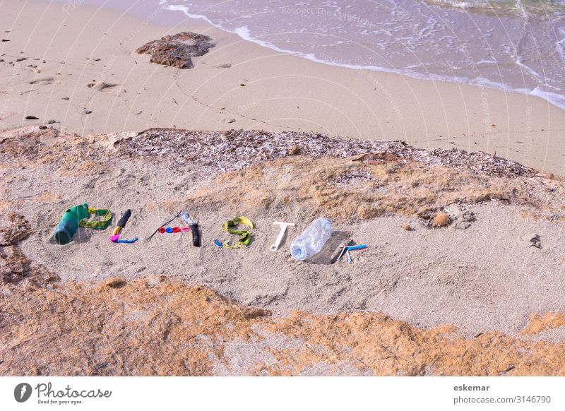 Plastic garbage on the beach Beach Ocean Environment Nature Sand Water Coast Packaging Plastic packaging Trash Plastic waste Sign Characters Word writing Lie