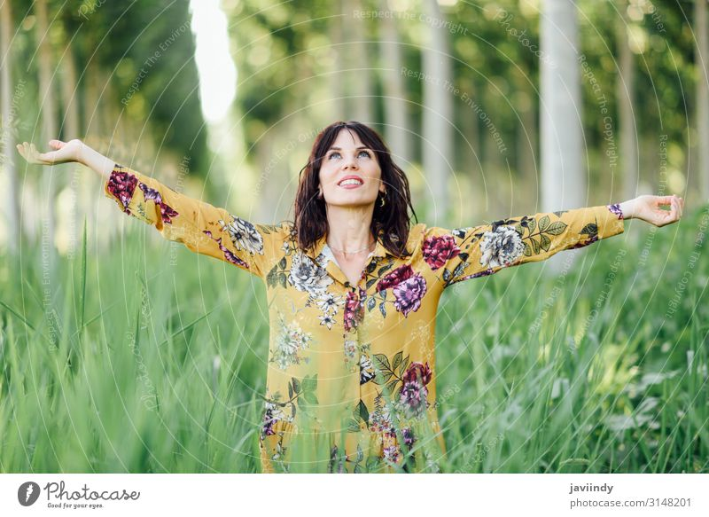 Woman arms raised enjoying the fresh air in green forest Human being Vacation & Travel Nature Youth (Young adults) Young woman Summer Beautiful Green Sun Tree
