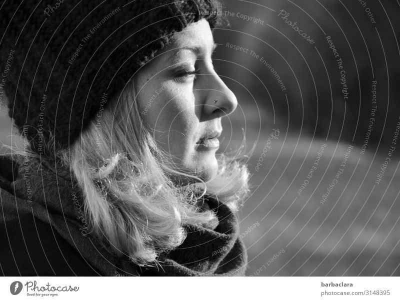 Enjoying the winter sun Woman Adults 1 Human being Nature Landscape Winter Beautiful weather Meadow Forest Scarf Cap Blonde To enjoy Bright Cold Warmth Emotions