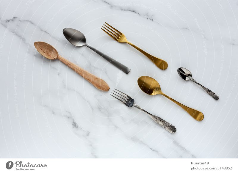Spoons and forks on white background Breakfast Lunch Fork Elegant Design Kitchen Tool Group Collection Metal Colour knolling flat lay food Set utensil equipment