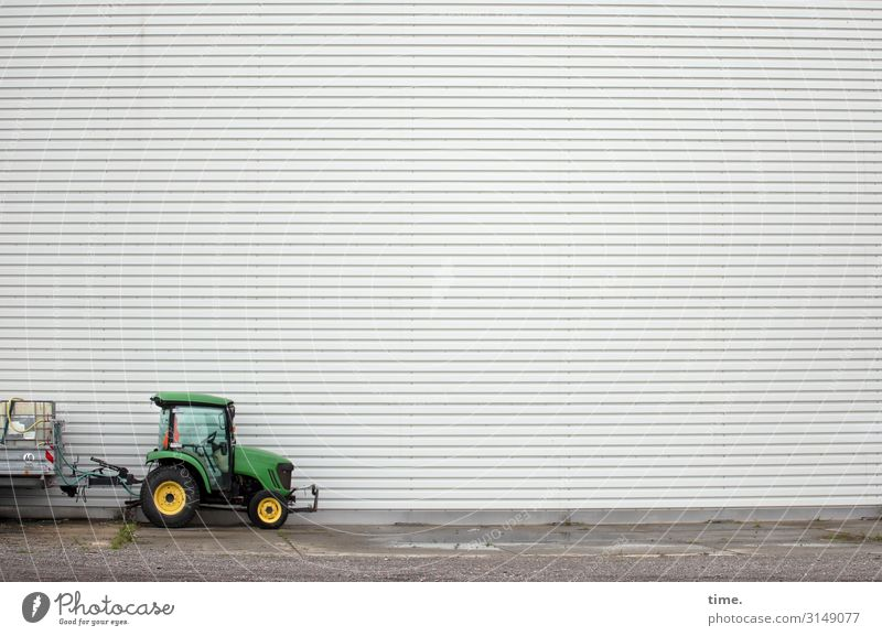 rest day Work and employment Workplace Craft (trade) Construction site Places Wall (barrier) Wall (building) Tractor Trailer Stand Tall Small Green Curiosity