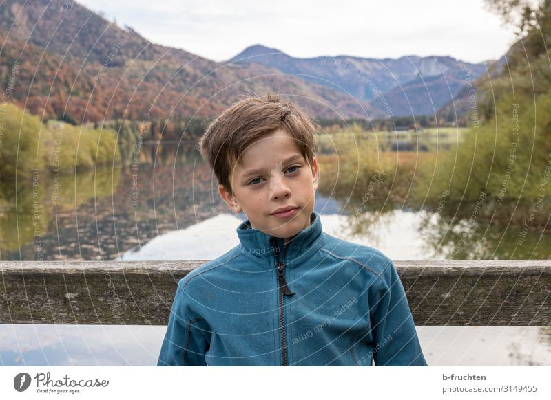 Child on wooden bridge, mountain lake Life Vacation & Travel Trip Adventure Mountain Hiking Boy (child) Face 1 Human being 8 - 13 years Infancy Environment
