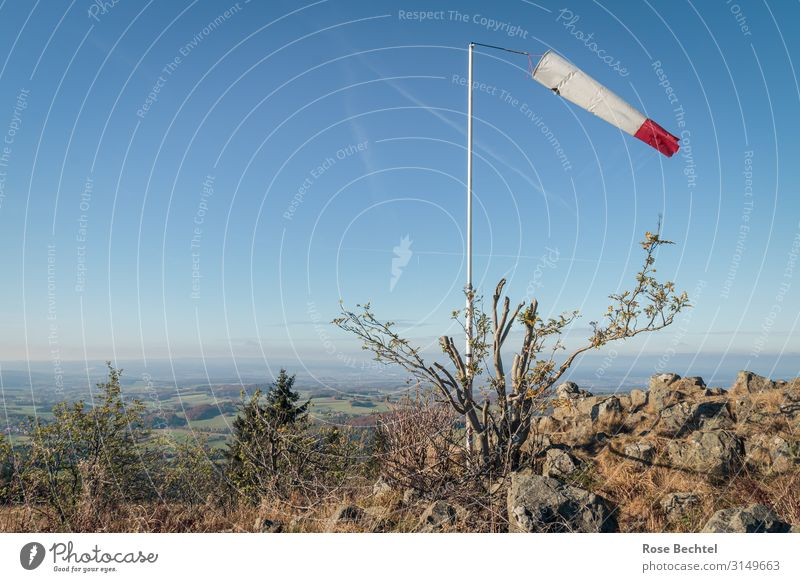 Red and white in the wind Landscape Cloudless sky Beautiful weather Hill Hiking Far-off places Wind Windsock Vane Rhön Wasserkuppe Colour photo Exterior shot